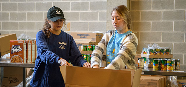 Students from the College of Health Sciences volunteering at a food bank.