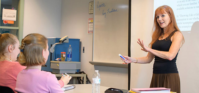 A Professor in the Associate in Arts Program lectures to engaged students
